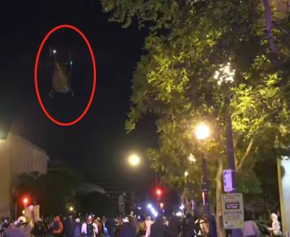 华盛顿街头成战区?美政府动用军机驱散抗议人群安卓版